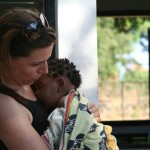 Volunteer With Child In Malawi